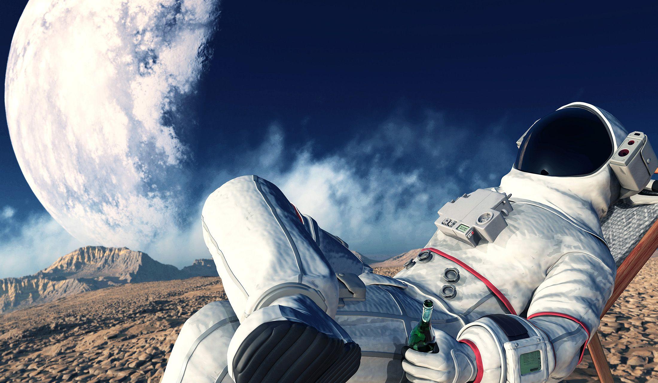 月面で地球を眺めながらカールスバーグを飲んでくつろぐ宇宙飛行士