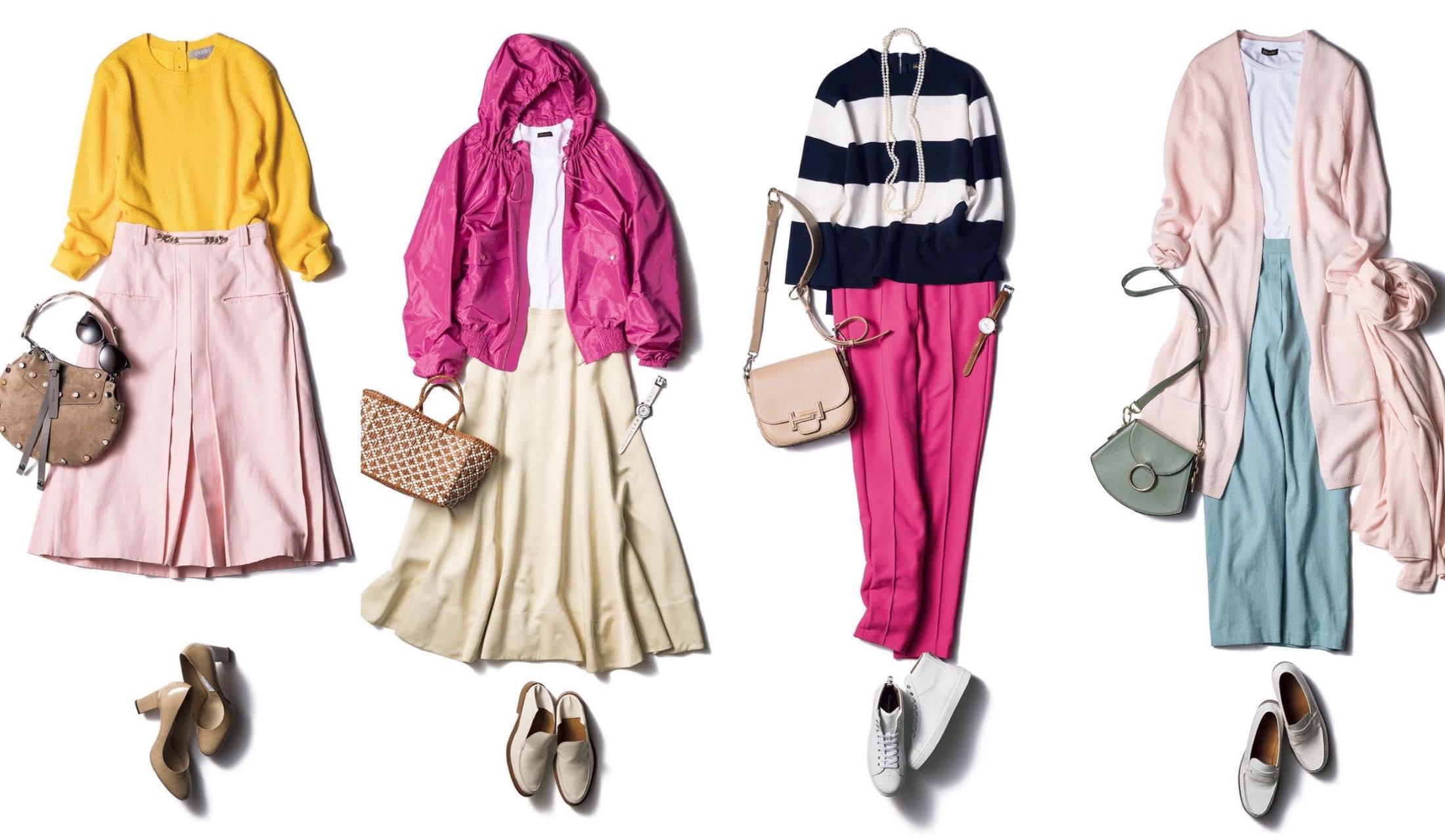ネイビーのタートルネックニットと、ピンクのパンツを履いた女性