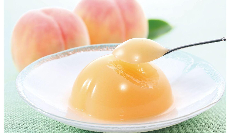 源 吉兆庵の「清水白桃ぜりぃ」の画像。桃のゼリーと桃が映っている。