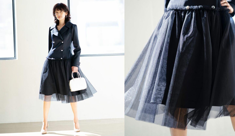 ネイビーのコートを着たモデル、高橋里奈さんとチュール部分のスカートのアップカット