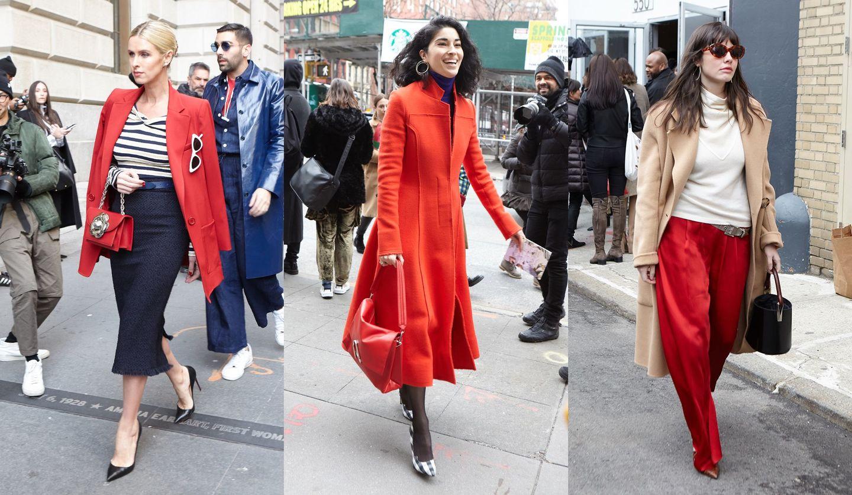 赤を取り入れたコーディネートの女性たちの海外のストリートスナップ写真