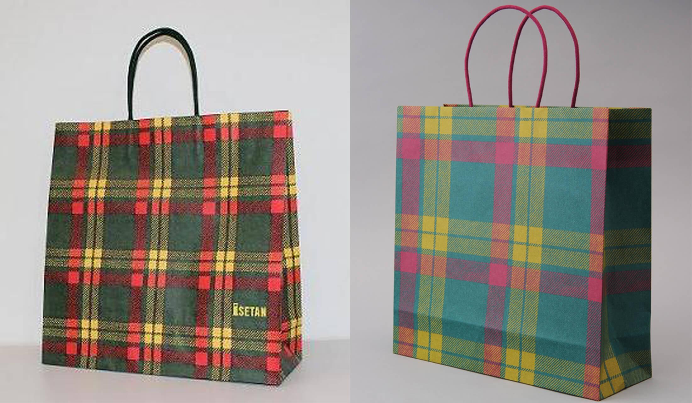 明るい緑地に濃いピンクと黄色の線が走る、伊勢丹タータンの「マクラミン/アンシェント」と新タータン柄「マクラミン/イセタン」の紙袋が並んだ画像